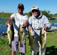 Buddy Byrd with big bass on the right.jpg